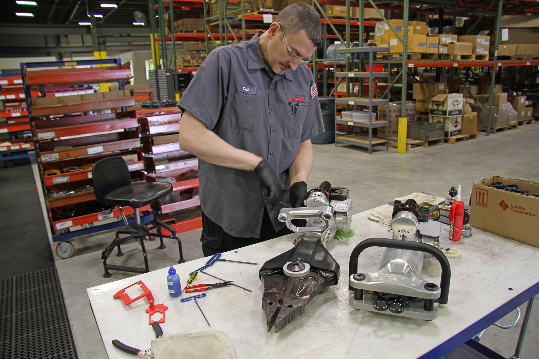 AMKUS employee working on a rescue tool